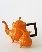 Orange teapot and milk jug
