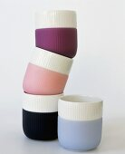 Four tea beakers in different colours
