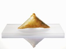 A mini spinach samosa with ginger