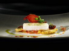 Turbot, jellied lovage topping and tomato flakes (molecular gastronomy)