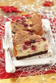 Two pieces of Christmas cherry cheesecake