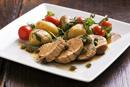 Pork fillet with a caper sauce, potaotes and cherry tomatoes