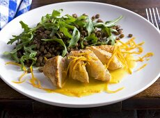 Chicken breast with orange sauce and lentil salad