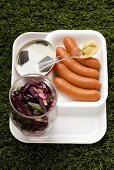 Frankfurters, red cabbages salad and mustard