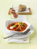 Onion and tomato soup with meat balls