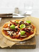 Pizza with mushrooms and dried tomatoes