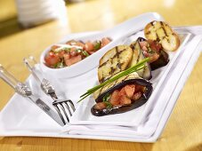 Grilled aubergine slices with tomato salsa