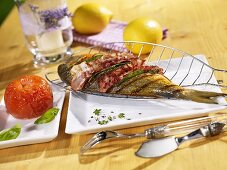 Grilled bream with bacon and sage