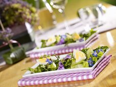 A green salad with boiled eggs, caper-vinaigrette and flowers