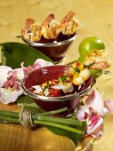 Scampi kebabs with pepper and basil salsa