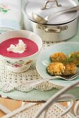 Beetroot soup with horseradish and fish cakes
