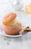 Orange sorbet served in a frozen orange for Christmas