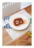 A pretzel on a plate