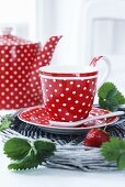 Polka dot cups on a wicker tray