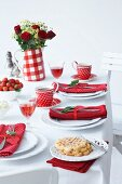 A table laid with strawberries and waffles