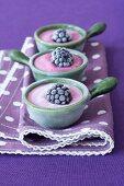 Semi-frozen yogurt with blackberries in ramekins