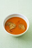 Cold red pepper soup with bread chips