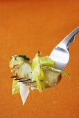 A forkful of apple and leek gratin