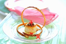Fried scallop with truffle caviar and garlic straws