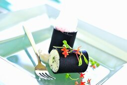 Squid ink cannelloni filled with king crab