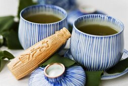 Green tea and Japanese sweet filled with bean paste