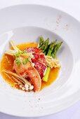 Lobster in coconut curry sauce, green asparagus & enoki mushrooms