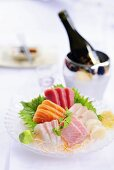 Assorted sashimi, sake bottle