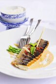 Fried sea bass fillet with curry sauce