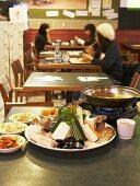 Asian seafood fondue in restaurant