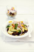 Bean salad with courgettes, tomatoes, avocado, onion and egg