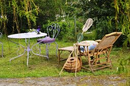 Lounger, fishing nets, creel, garden table and chair