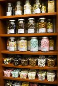 Sugared almonds of various colours on shelves