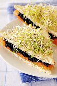 Smoked salmon & lumpfish roe sandwiches with alfalfa sprouts