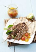 Veal kebabs (loin) with melon chutney and wraps