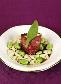 Saltimbocca with farfalle and beans