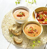Cream of tomato soup, fresh tomatoes and bread