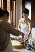 Thai women cooking