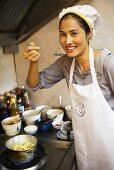 Female Thai chef tasting food