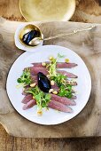 Duck breast with port wine jelly and salad leaves