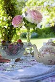 Teapot, cherries & roses on garden table (Château de la Verrerie, France)