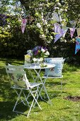 Garden table and chairs with bunting
