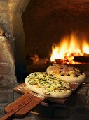 Focaccia with ceps and with onions in pizza oven