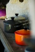 Various pans in rustic kitchen