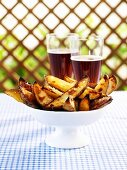 Spicy chilli potato wedges, glasses of beer