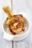 Bacon-wrapped chicken leg