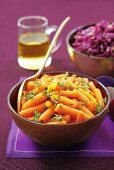 Buttered carrots with thyme, and a red cabbage salad in the background