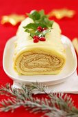 Sponge roll with coffee cream filling and white chocolate (Christmas)