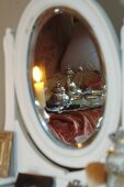 Breakfast tray reflected in bedroom mirror
