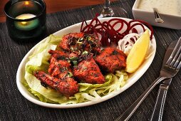 Tandoori chicken on iceberg lettuce