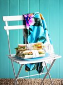 Baguette sandwiches on garden chair